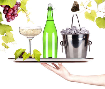 grapes, ice bucket,butterfly with bottle of champagne and glass on a silver tray isolated on a white baclground photo