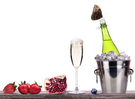 summer fruits and ice bucket  with champagne