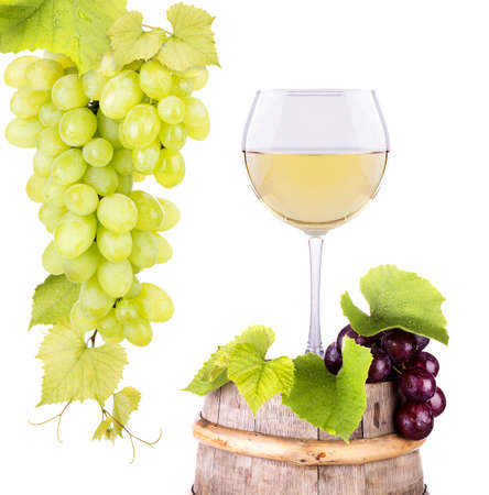 white wine: grapes and wine glass on a wooden vintage barrel