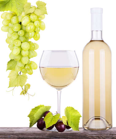 glass of white wine and a bottle with grapes photo