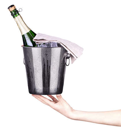bottle of champagne in ice bucket photo