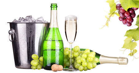 grapes, ice bucket  with champagne isolated photo