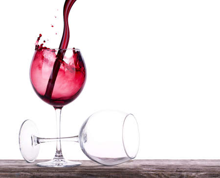 pair of full and empty wine glasses Stock Photo