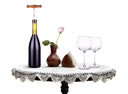 glass of  wine and a bottle with flower photo
