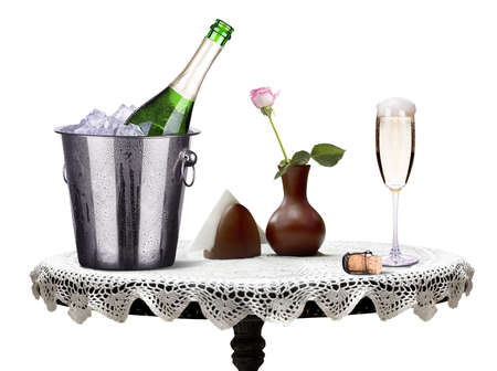 glass and bottle of champagne in ice bucket photo