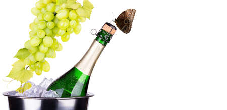 bottle of champagne with grapes photo