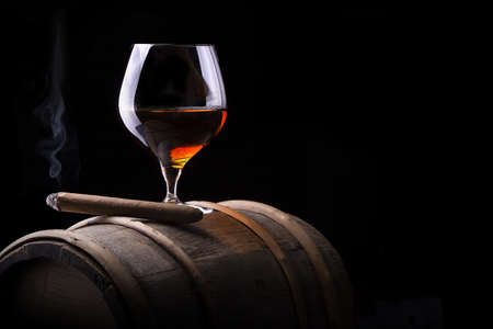 drunks: Cognac and Cigar on black with vintage barrel