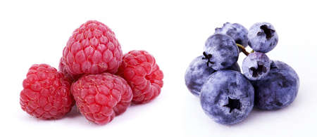 bilberries: Fresh Bilberries and raspberry Stock Photo