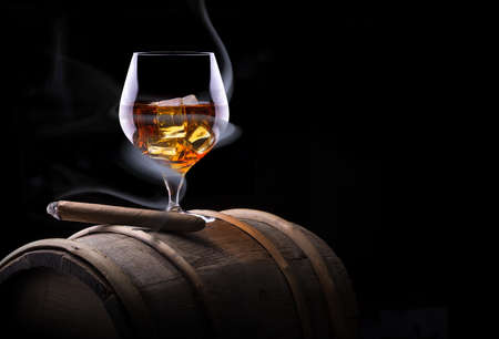 Cognac glass shrouded in a smoke photo