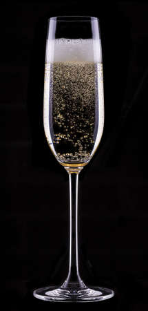 champagne glass: glass of champagne isolated on black background Stock Photo