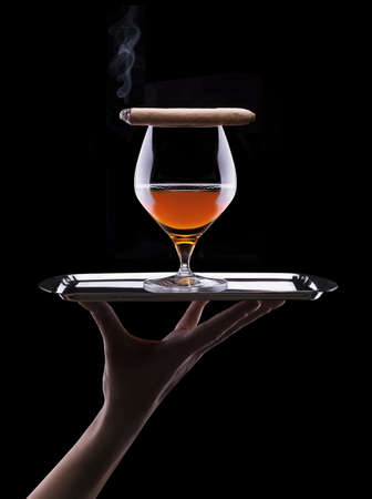 Cognac and Cigar on black photo