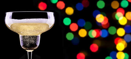 glass of champagne isolated on party background photo