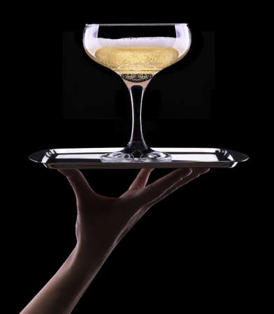 glass of champagne isolated on black background photo