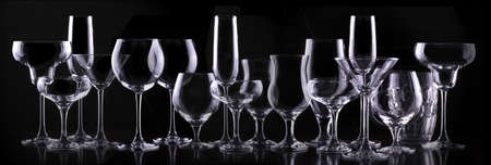 set with different empty glasses photo