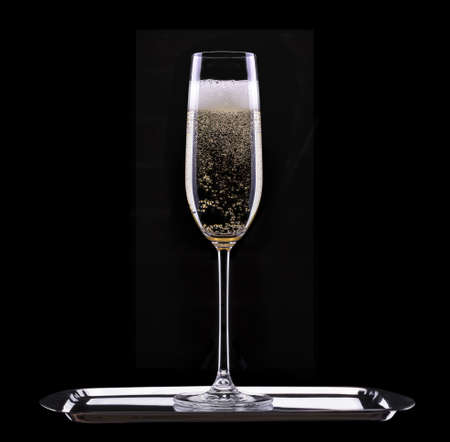 glass of champagne isolated on black background Stock Photo