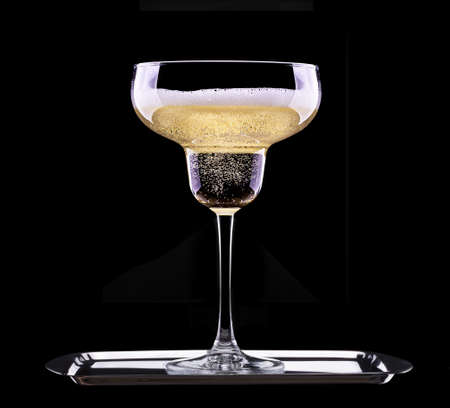 champagne flute: glass of champagne isolated on black background Stock Photo