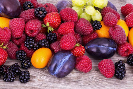 tasty summer fruits on a wooden table photo