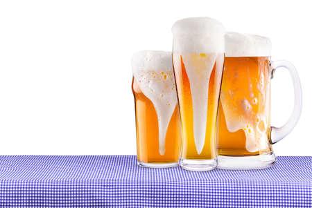 Oktoberfest Celebration Background with frosty fresh Beer isolated photo