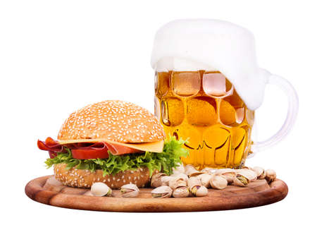 Closeup of homemade burger and a cold beer with pistachios photo