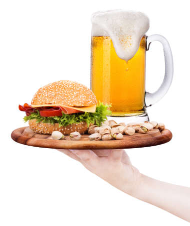 Closeup of homemade burger and a cold beer with waiter hand photo