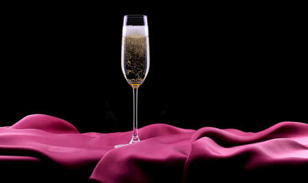 glass of champagne and red rose on black background photo