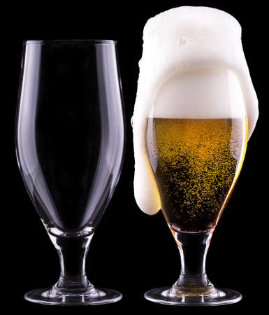 full and empty glass of light beer  isolated on a black background photo