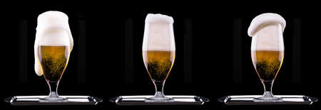 Frosty glass of light beer  isolated on a black background photo