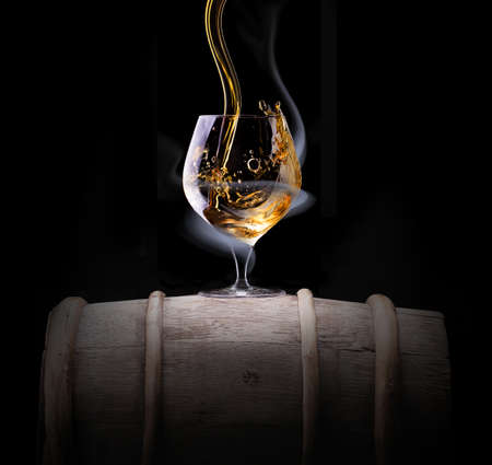 Cognac glass shrouded in a smoke on a black background Stock fotó - 21733281