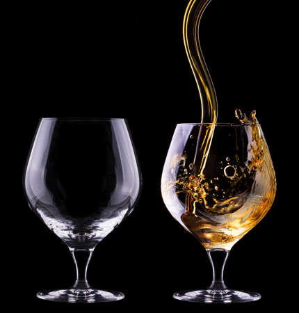 Cognac or brandy full and empty glass on a  black background photo