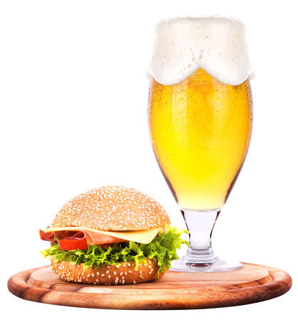 Closeup of homemade burger and a cold beer with foam photo