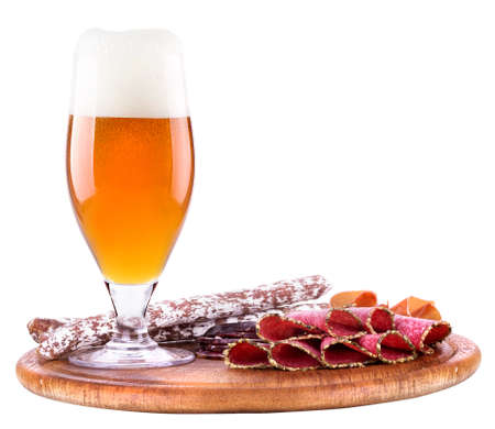 various types of sausages and beer isolated background photo