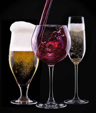 alcohol drinks set isolated on a black background - beer,wine,champagne photo