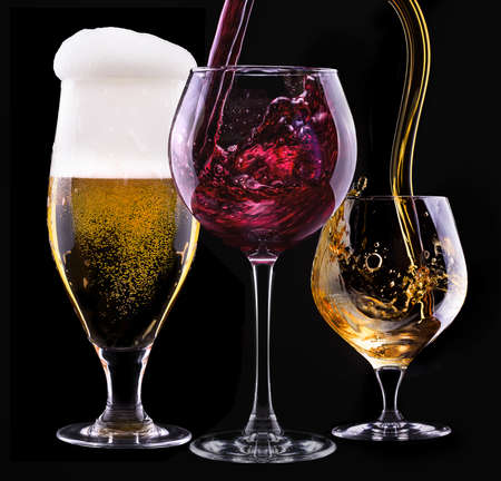 alcohol drinks set isolated on a black background - beer,wine,scotch photo