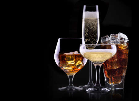 whiskey glass: set with different drinks on black background - champagne,cola,cocktail,wine,brandy,whiskey,scotch,vodka,cognac Stock Photo
