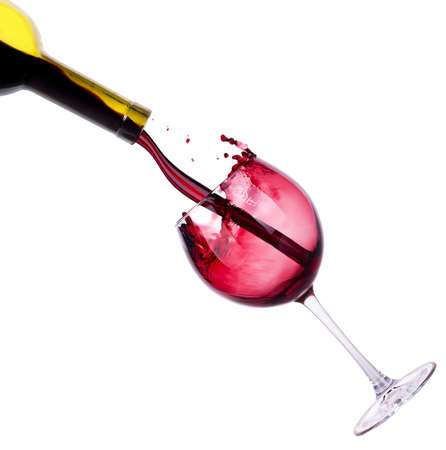 Splash red wine  against a white background photo