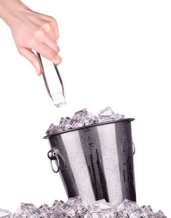 ice bucket with hand holding tongs isolated on a white background photo