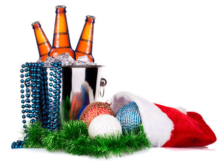 beer and christmas decor isolated on a white photo