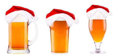 Beer and hat of Santa Claus isolated on white photo