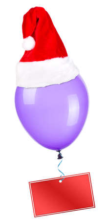 Empty card hanging on color flying balloon with santa hat photo
