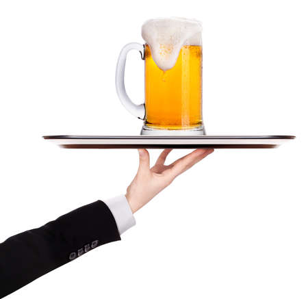 waiter holding  silver tray with beer isolated on a white background photo