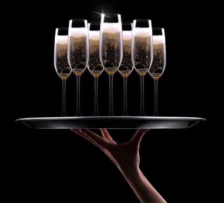 champagne glass: waiter hand with champagne on black background