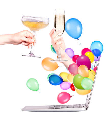 powerbook: A champagne glass. A toast of your friend on the Internet. Isolated on white. Stock Photo