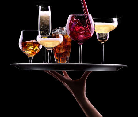 tray with different drinks on black - champagne, beer, cocktail, wine, brandy, whiskey, scotch, vodka, cognac Stock Photo - 24191832