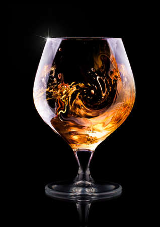 drunks: Cognac or brandy on a  black background Stock Photo