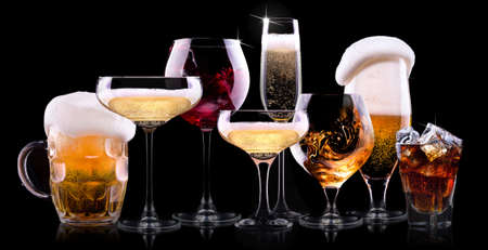 set with different drinks on black background - champagne,cola,cocktail,wine,brandy,whiskey,scotch,vodka,cognac Stock Photo