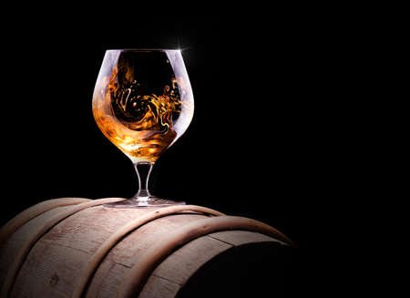Cognac or brandy on a  black background 版權商用圖片