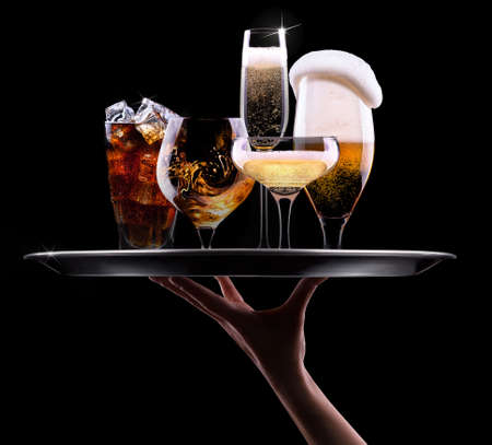 tray with different drinks on black background - champagne, beer, cocktail, wine, brandy, whiskey, scotch, vodka, cognac photo