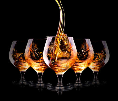 Cognac or brandy on a  black background Stockfoto