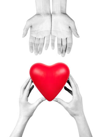 Health insurance or love concept isolated with hand and heart photo