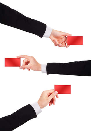 Businessmans hand holding business card isolated on white background photo